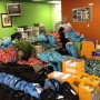Teen helps pack up backpacks and school supplies to be sent to Colorado students at the Step by Step headquarters in Florida. Photo by Liliane Stransky/Step by Step.