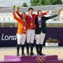 On the podium, the individual show jumping medalists: Gerco Schroder, the Netherlands, silver; gold medalist Steve Guerdat, Switzerland; Cian O'Connor, Ireland, bronze. © Nancy Jaffer